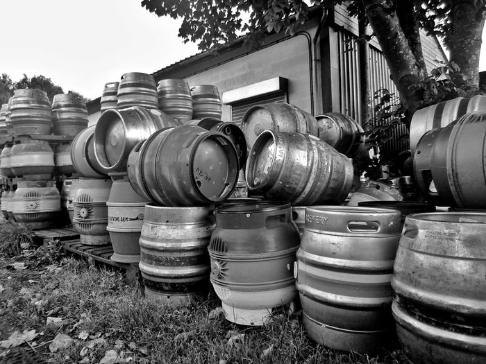Stack Of Beer Barrels By House