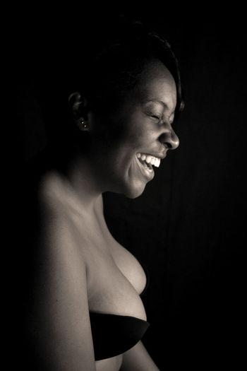 Netania. Profile View Black Background Studio Shot One Person Human Face Smile Formal Portrait Black And White Noirphotography Jamaicanphotographer Jamaica Portrait Shirtless Jamaican Girl  Blackgirlmagic Blackgirl EyeEmNewHere