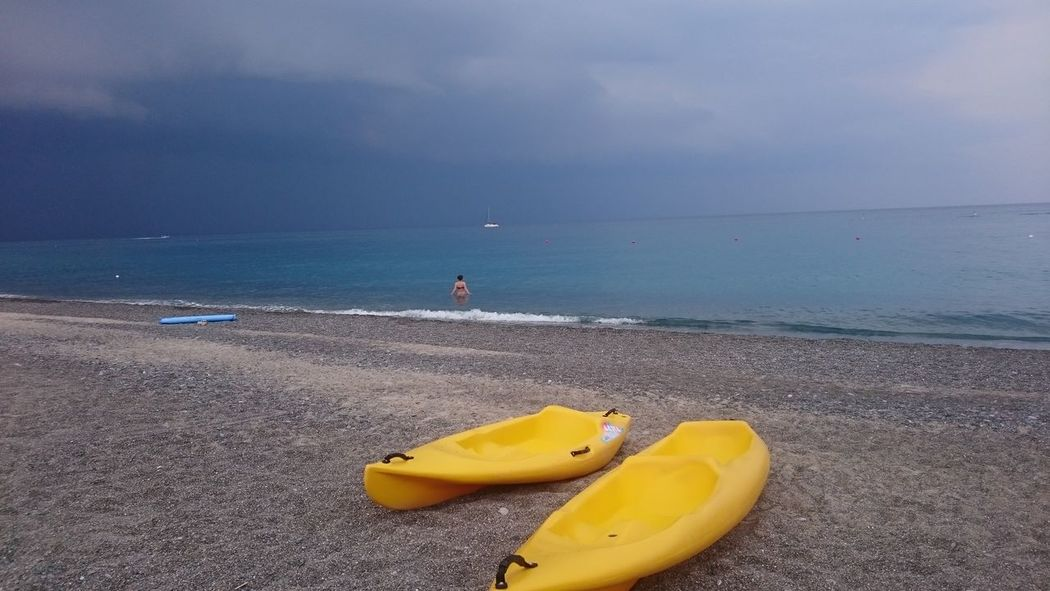 Beach Sea Sand Water Yellow Leisure Activity Outdoors Vacations Day Nautical Vessel Horizon Over Water Sky One Person Nature People