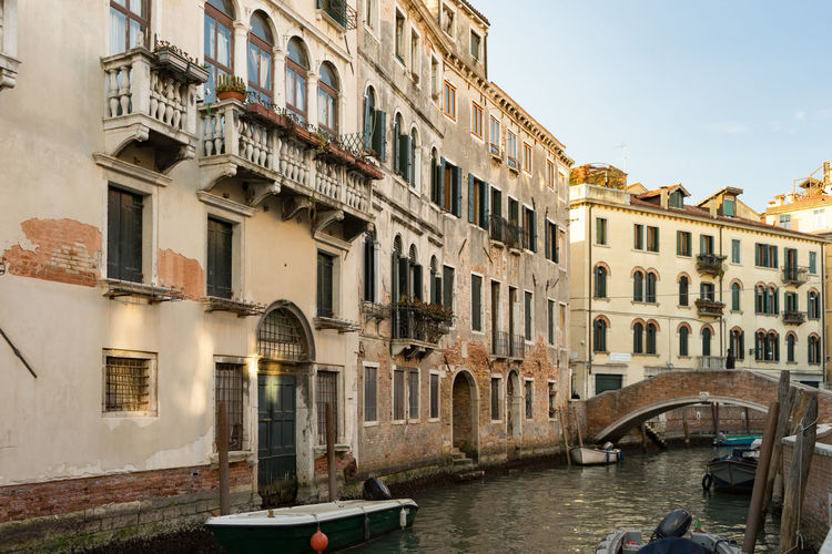 Canal in Venice, Italy Built Structure Architecture Building Exterior Nautical Vessel Canal Water Transportation Mode Of Transportation Window Building City Day Arch Nature Travel Destinations Travel Bridge Residential District Gondola - Traditional Boat Outdoors Passenger Craft Venice, Italy