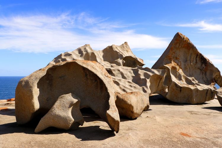 Remarkable Rocks is a set of 500 million year old sculptured granite boulders set in the Flinders Chase National Park on Kangaroo Island South Australia Sky Rock Cloud - Sky Nature Solid Sea Rock - Object Tranquility Rock Formation Scenics - Nature Tranquil Scene Water Beauty In Nature Day Land No People Outdoors Travel Destinations Eroded Remarkable Rocks Australia Kangaroo Island Travel Photography Granite Rocks Erosion