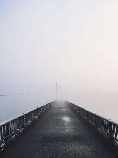 Empty Pier In Foggy Weather