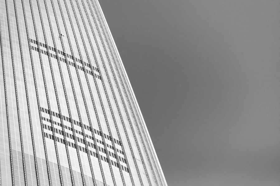 Gigantic wall Low Angle View Architecture Built Structure Building Exterior Tall - High Building Story Modern Office Building Skyscraper Skyline Exterior Seoul Korea Lotte Lotteworld Tower Blackandwhite Monochrome Colors And Patterns Lines Glass - Material Repetition No People Development Skyscrapers Tall