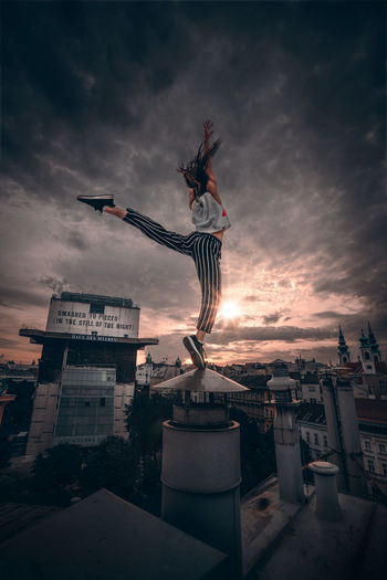 EyeEmNewHere EyeEm Best Shots EyeEm Selects EyeEm Gallery Portrait Portrait Of A Woman Women Acrobatics  Young Women Yoga Pose Acrobatic Activity Sport Spirituality Dream Urbexphotography Shadows & Lights Fitness Happiness Swing Jump Sunset Sky Cloud - Sky My Best Photo 17.62°