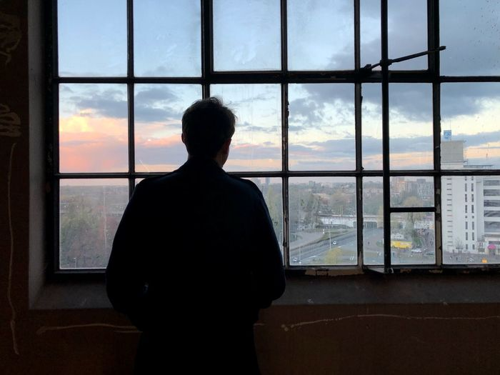 Melancholy man Thinking Thinking About Life Melancholy Window Sky One Person Real People Glass - Material Rear View Transparent Silhouette Indoors  Sunset Looking Through Window Cloud - Sky Looking At View Looking