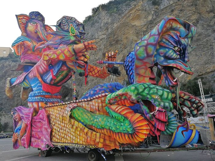 Maiori, Campania, Italy - March 4, 2019: Allegorical floats in the square of the port for the 46th edition of the Grand Carnival of Maiori Italy Campania Salerno Italy Grand Carnival Of Maiori Amalfi Coast Colorful Floats Carnival - Celebration Event Allegorical Floats Maiori, Day Representation Art And Craft Multi Colored Creativity Sculpture Statue Belief Human Representation Craft Dragon Spirituality Outdoors Festival