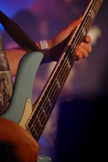 Music Musical Instrument Arts Culture And Entertainment String Instrument Guitar Human Hand Artist Musical Equipment Playing Human Body Part Hand Musician Performance Plucking An Instrument One Person Guitarist Rock Music Musical Instrument String Body Part Electric Guitar Finger Skill  Stage Bass Guitar Entertainment Occupation