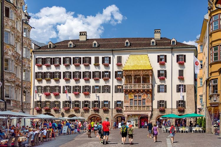 Austria 🇦🇹 Tyrol, Innsbruck、the Golden Roof (Goldenes Dachl)✨オーストリア、インスブルック、ゴールデンルーフ、インスブルックのシンボル、旧市街の有名な黄金の屋根 Austria Photos Tirol Innsbruck Österreich Tirol Crowd Architecture Large Group Of People Group Of People Building Exterior Built Structure Real People City Sky Lifestyles Day Street Nature Cloud - Sky Building