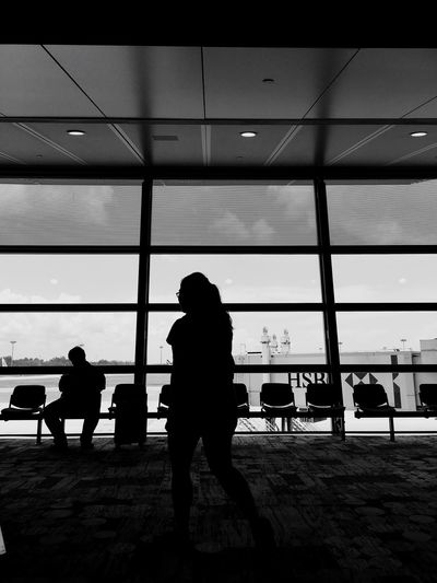 Starting point. Miles Away Silhouette Airport Men Indoors  Day People