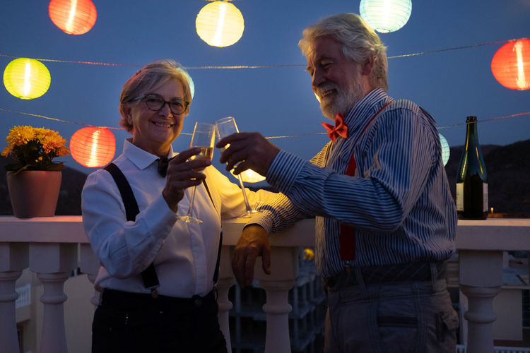 Smiling senior couple with wineglasses
