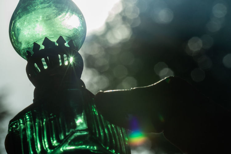 Magic Lantern (3/3) Art And Craft Green Color Reflection Shiny Sphere Close-up Colorful Craft Decoration Focus On Foreground Glass - Material Human Representation Illuminated Magic No People Outdoors Representation Selective Focus Still Life Capture Tomorrow