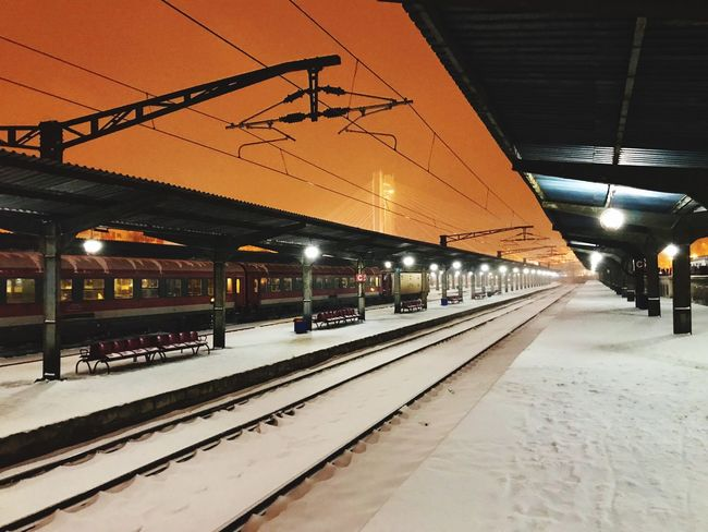 Transportation Railroad Station Rail Transportation Railroad Station Platform Railroad Track Illuminated Built Structure Public Transportation Winter Outdoors Architecture No People Night Let's Go. Together. Stories From The City