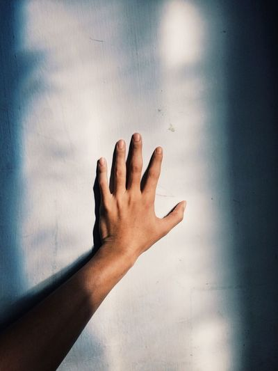 Close-Up Of Hand On Wall