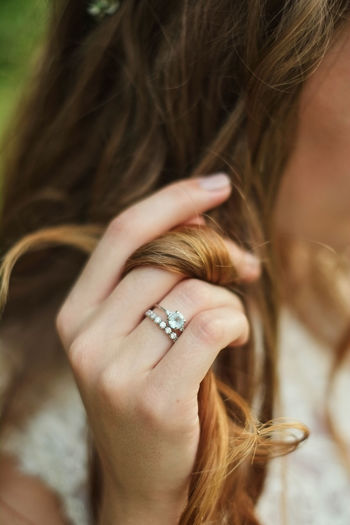 Close-Up Of Woman Wearing Finger Rings Holding Her Hair