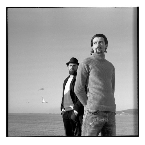 A series of black and white photos on the beach in a winter sunny day. Shooting by the sea. Portraits with natural light. Candid Authentic Moments Authentic Lifestyles Lifestyle Blackandwhite Black And White Standing Sky Young Men Two People Casual Clothing Three Quarter Length Sea Togetherness Looking At Camera Men Portrait Real People People Water Clothing Young Adult Clear Sky Horizon Over Water