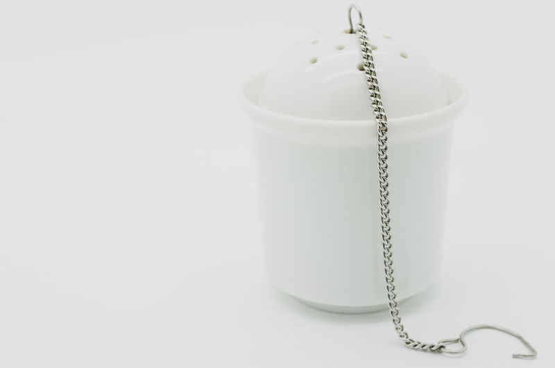 infuse strainer Studio Shot Indoors  White Background Close-up No People White Color Copy Space String Still Life Rope Single Object Thread Tied Up Simplicity Food And Drink Chain Metal Cut Out Necklace Drink Strainer Teas Strainer White Porcelain