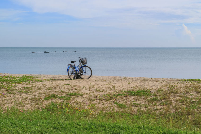 Samila Beach Songkhla Province Thailand Bicycle Sea Water Horizon Over Water Sky Cycling Outdoors Day Nature Beach Grass