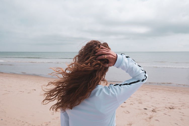 The Week on EyeEm Arms Raised Beach Cloud - Sky Hair Hairstyle Horizon Horizon Over Water Land Leisure Activity Lifestyles Long Hair Nature One Person Outdoors Real People Sand Sea Sky Waist Up Water Wind Women