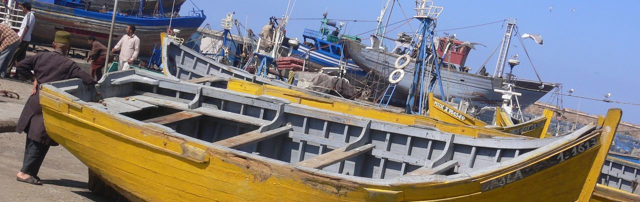 The boats of Mogador Boat Fishing Boats Harbour View Mediterranean  Mogador Nautical Vessel Outdoors Port Primary Colors Transportation Travel Photography Traveling Voyages Wood Wooden Yellow Paint The Town Yellow
