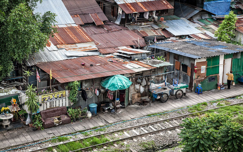 Community Poor  Railroad Community Thailand Architecture Building Exterior Built Structure Congestion Corrugated Iron Day House No People Outdoors Overcrowded Roof Slum Urban