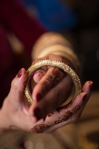 IndianWedding Bride putting on her Bangles 2