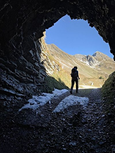 Through the tunnel Rock Mountain Leisure Activity Hiking Tunnel Scenics - Nature Outdoors Real People Adventure Female Figure darkness and light