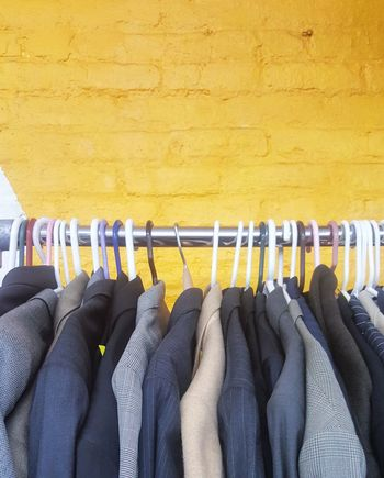 EyeEm Selects Hanging Coathanger Clothing Rack Variation In A Row Clothing Store Indoors  Fashion Multi Colored Business Finance And Industry No People Coat Hook Textile Choice Business Close-up Day