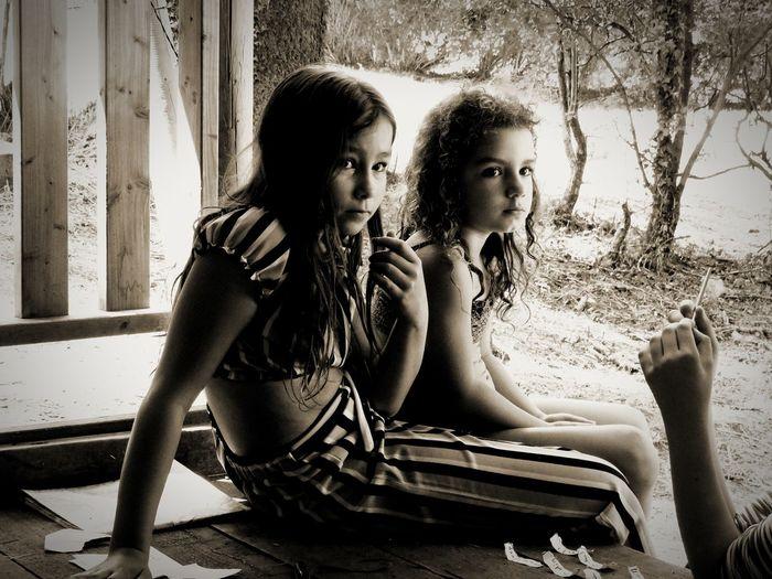 Siblings sitting on table