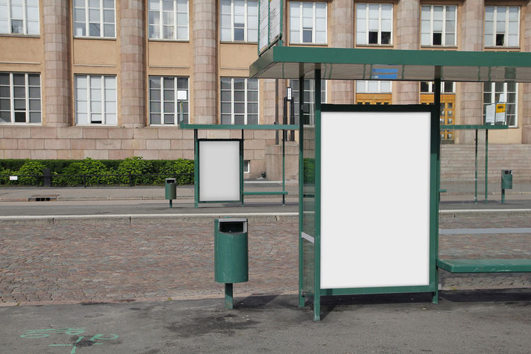 Blank billboard in a bus stop Advertising Billboards Advert Advertisement Architecture Billboard Blank Building Building Exterior Built Structure Bus Stop City Commercial Sign Communication Copy Space Empty Footpath Marketing Message Mock Up No People Outdoors Placard Sign Street