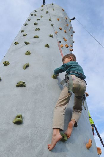 Up he goes Activities Children Kids People Watching Scaling New Heights Active Lifestyle  Adventure Balance Boys Challenging Child Building Strength And Balance On A Climbing Wall Climbing Climbing Rope Climbing Wall Educational Extreme Sports Outdoors Person Practicing Climbing Practicing Rock Climbing Reaching New Heights Rock Climbing Up A Wall Sky Background Young Boy Young Boy Learning To Climb