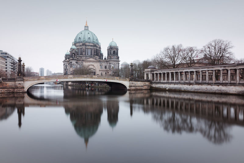 Berlin Cathedral on a grey winter morning Architecture Berlin Berlin City Bridge - Man Made Structure Building Exterior City Cityscape Clinical Look Day Dome Fineartphotography Longexposure Muted Colors No People Outdoors Philipp Dase Reflection Reflection In The Water Sky Travel Destinations Tree Urban Icon Water Winter Discover Berlin
