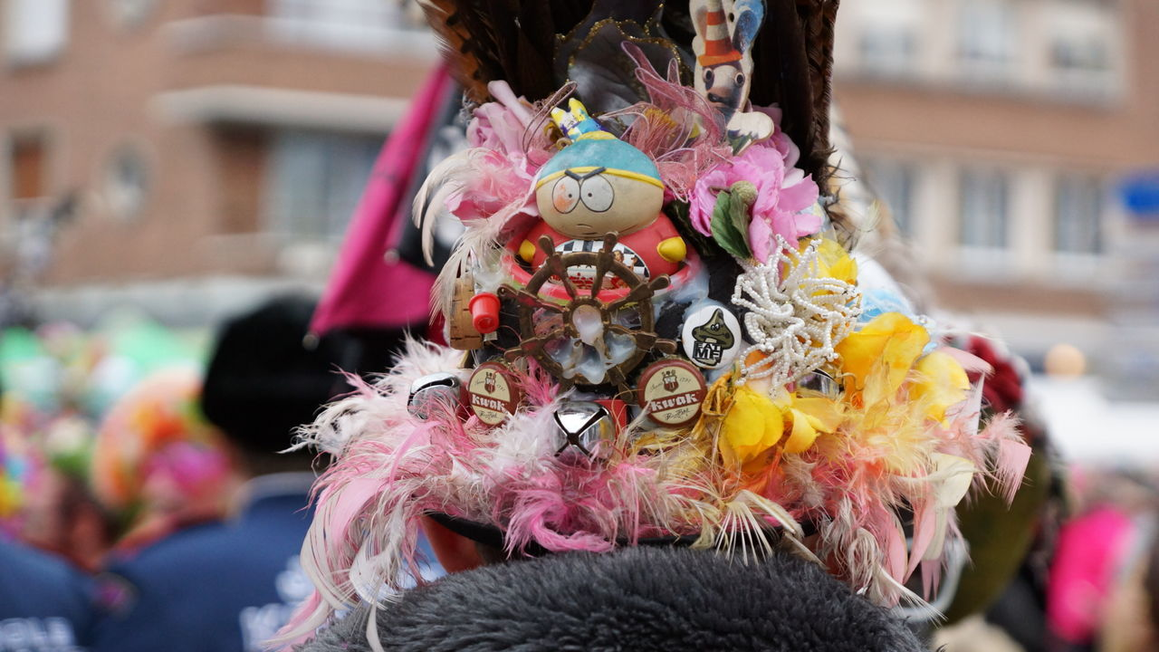 costume, real people, focus on foreground, day, carnival, leisure activity, outdoors, men, celebration, wearing, multi colored, one person, close-up, clown