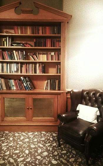 Sitting area in a library // Library Books Reading Resting Carpet Comfortable Chair Cosey Hall Cheshire