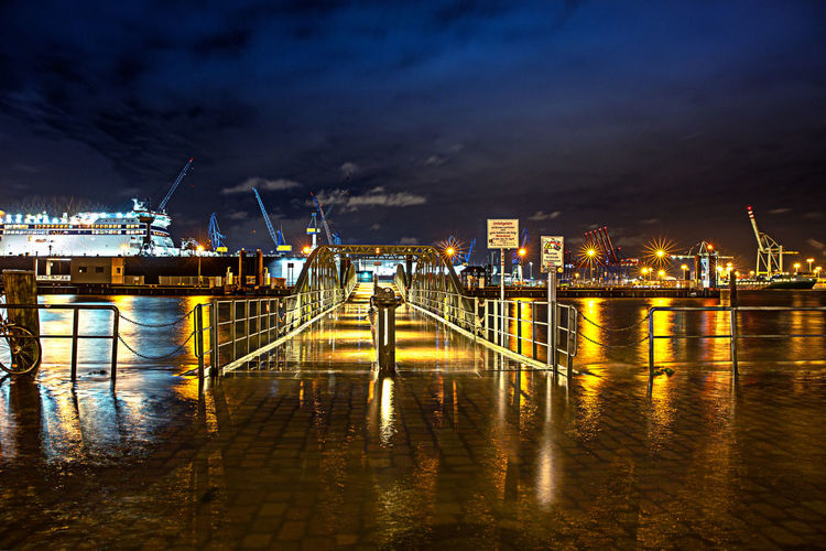 Water Sky Night Reflection Illuminated Transportation Pier Architecture Cloud - Sky Built Structure Nature Building Exterior Industry No People Mode Of Transportation Harbor Outdoors Power In Nature Hamburg Hamburg Harbour Hamburg Fischmarkt Flood Flooding High Tide