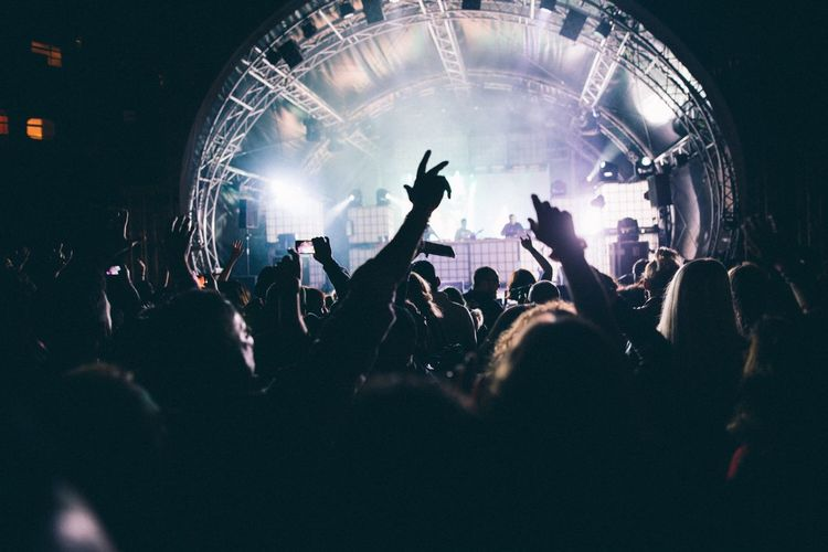 Nightlife Arts Culture And Entertainment Popular Music Concert Music Arms Raised Crowd Performance Audience Event Stage - Performance Space Night Illuminated Stage Light Fun Youth Culture Concert Hall  Large Group Of People People Enjoyment Group Of People
