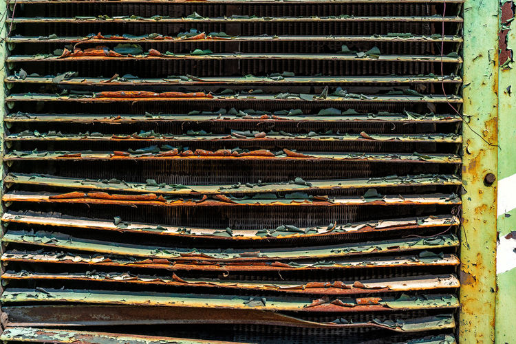 Rusty wall of a diesel locomotive Old Rusty Diesel Locomotive Locomotive Rusty Wall No People Full Frame Metal Backgrounds Pattern Barbecue Food And Drink Barbecue Grill Grilled Close-up Large Group Of Objects Freshness Meat Day In A Row Abundance Food Outdoors