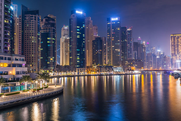 Dubai marina. illuminated modern buildings in city at night