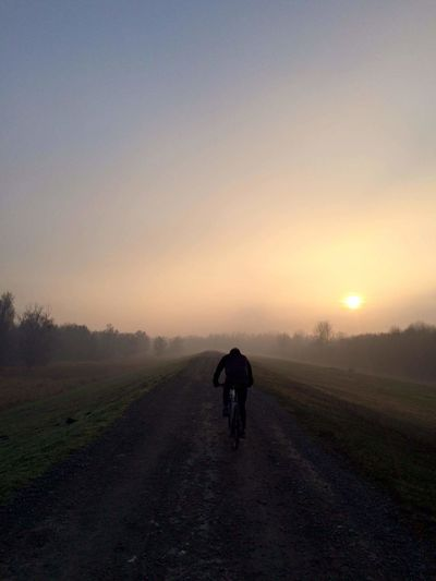 Sunset Rural Scene Adult One Person People Landscape Silhouette One Man Only Fog Road Adventure Only Men Agriculture Men Healthy Lifestyle Sky Adults Only Nature Outdoors Scenics Me Driving Around