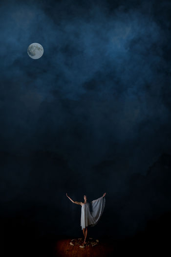 Full length of man standing on moon at night