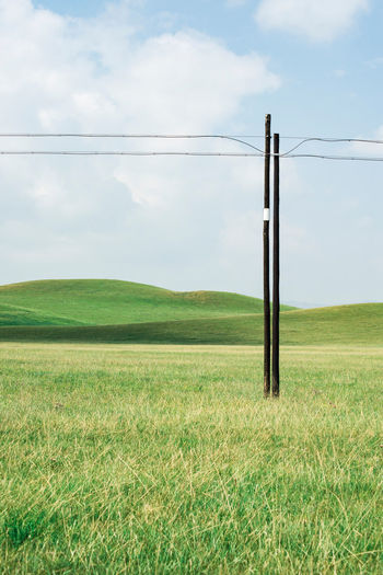 Tranquility Calm Empty Field Grass Grassland Grassy Green Green Color Landscape Meadow Mountain Nature Peaceful Pole Power Line  Prairie Scenics Serene Sky Space Tranquil Scene Tranquility Vast