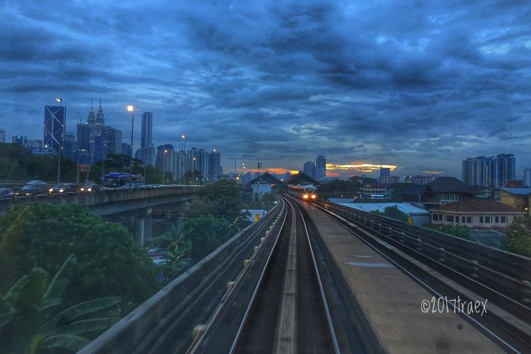 Dusky Hours Architecture City Transportation Building Exterior Built Structure Sky Cloud - Sky Illuminated The Way Forward Modern Skyscraper High Angle View Cityscape No People Futuristic Urban Skyline Outdoors Travel Destinations Bridge - Man Made Structure Connection