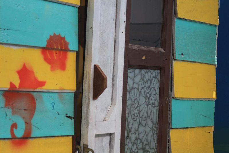Full frame shot of graffiti on door of building
