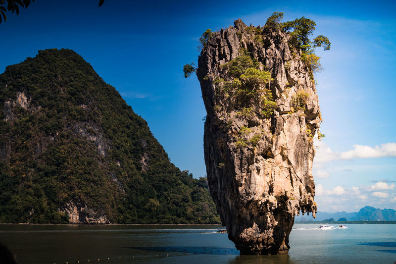 James Bond island details Water Sea Sky Scenics - Nature Beauty In Nature Tranquil Scene Nature Rock Formation Tranquility Land No People Tree Rock Mountain Plant Day Non-urban Scene Rock - Object Cliff Outdoors Stack Rock Bay Eroded Phuket Thailand