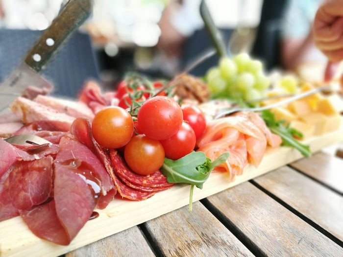 Close-Up Of Meat And Vegetables Served On Table