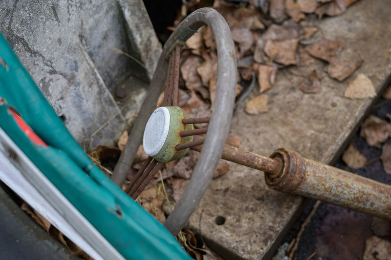 High angle view of rusty steering wheel in abandoned car
