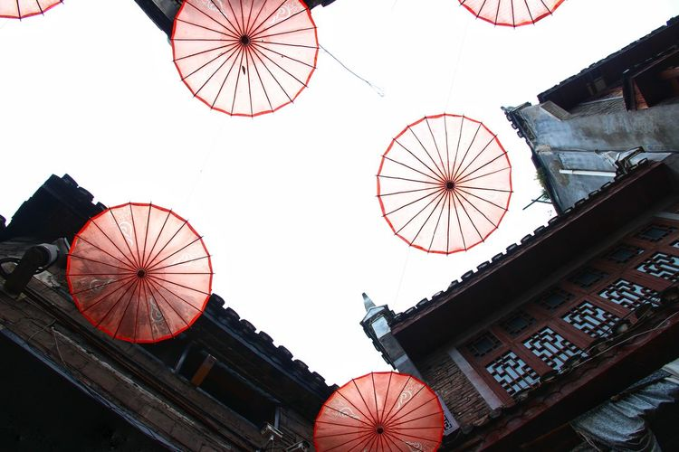 Low angle view of lanterns against clear sky