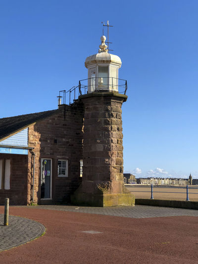 View of lighthouse against clear blue sky