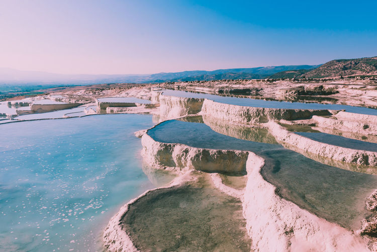 Scenic view of pamukkale against sky