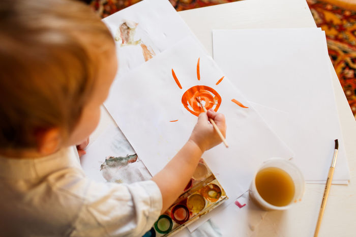 A cute kid drawing with watercolors Drawing Education Family Girl Hapiness Kid Little Girl Sun Talent Talented Watercolor Watercolor Painting