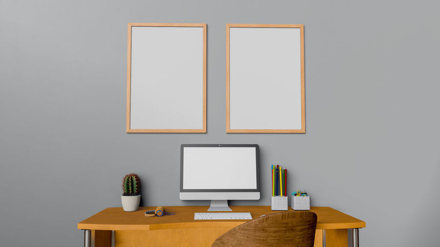 Table Indoors  Copy Space No People Blank Desk Frame Still Life Technology Furniture Picture Frame Publication Wood - Material Board Pencil Book Wall - Building Feature Education Connection Creativity